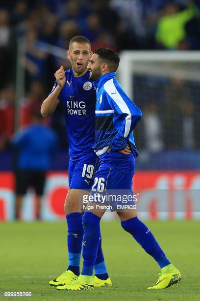 Leicester City's Islam Slimani and Leicester City's Riyad Mahrez after the final whistle