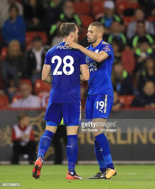 Leicester City's Islam Slimani celebrates scoring his side's second goal of the game with team mate Leicester City's Christian Fuchs during the...
