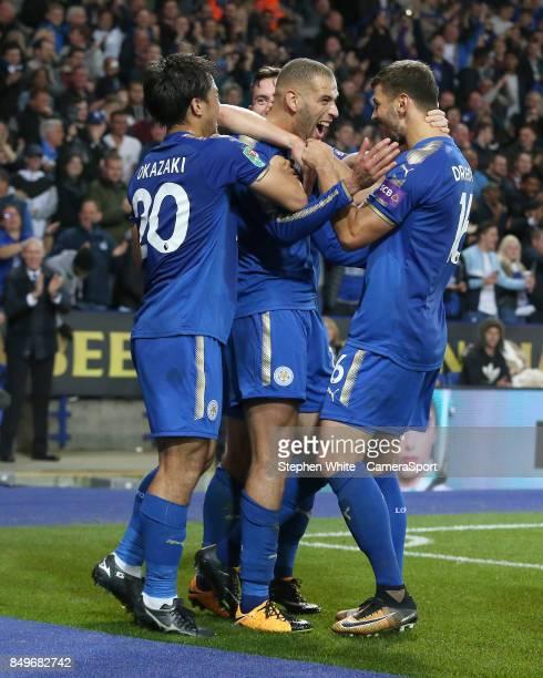 Leicester City's Islam Slimani celebrates scoring his side's second goal with teammates Shinji Okazaki and Aleksandar Dragovic Referee Stuart Attwell...