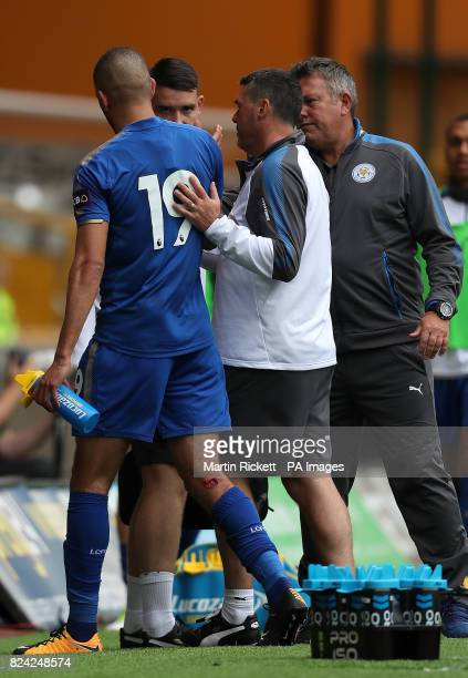 Leicester City's Islam Slimani goes off with a leg injury against Wolverhampton Wanderers during the preseason match at Molineux Wolverhampton