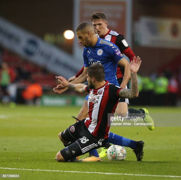 Leicester City's Islam Slimani is tackled by Sheffield United's Kieron Freeman during the Carabao Cup Second Round match between Sheffield United and...