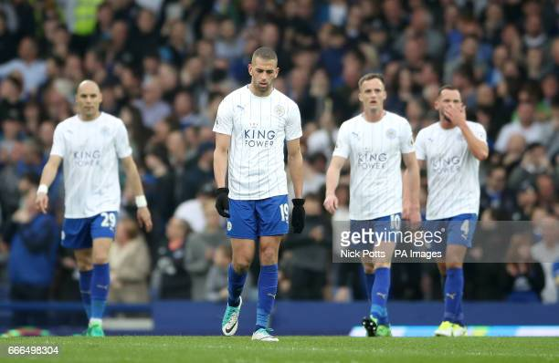 Leicester City's Islam Slimani looks dejected alongside teammates during the Premier League match at Goodison Park Liverpool