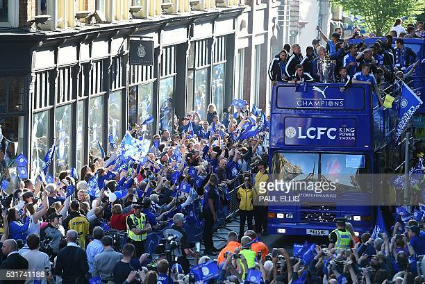 Leicester City's Italian manager Claudio Ranieri holds the Premier league trophy as the Leicester City team take part in an opentop bus parade...