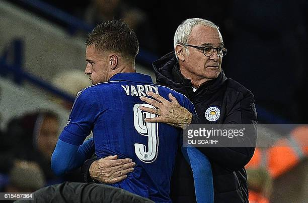 Leicester City's Italian manager Claudio Ranieri hugs Leicester City's English striker Jamie Vardy as Vardy is substituted off of the pitch during...