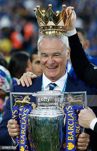 Leicester City's Italian manager Claudio Ranieri poses with the Premier League trophy after winning the league and the English Premier League...