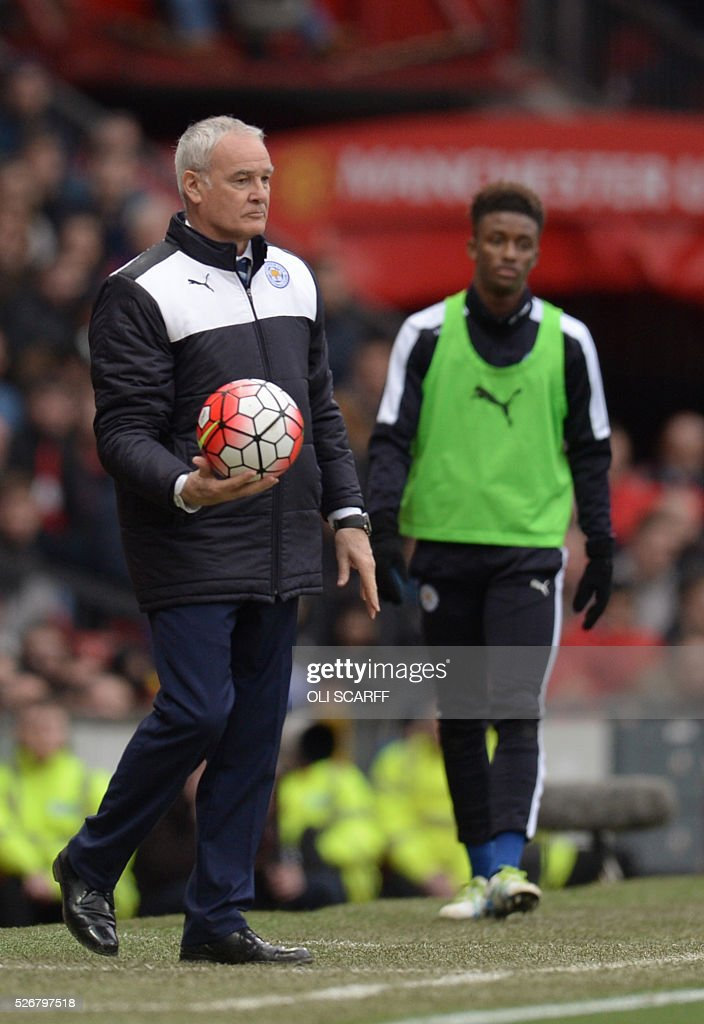 Leicester City's Italian manager Claudio Ranieri returns the ball from the touchline during the English Premier League football match between Manchester United and Leicester City at Old Trafford in Manchester, north west England, on May 1, 2016. / AFP / OLI SCARFF / RESTRICTED TO EDITORIAL USE. No use with unauthorized audio, video, data, fixture lists, club/league logos or 'live' services. Online in-match use limited to 75 images, no video emulation. No use in betting, games or single club/league/player publications. /