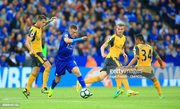 Leicester City's Jamie Vardy and Arsenal's Francis Coquelin battle for the ball