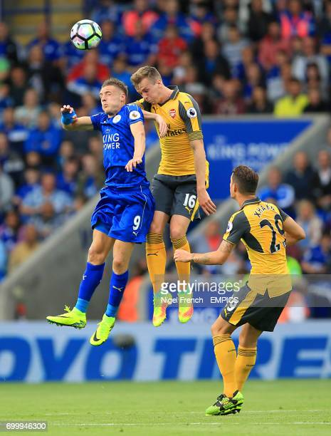 Leicester City's Jamie Vardy and Arsenal's Rob Holding battle for the ball in the air