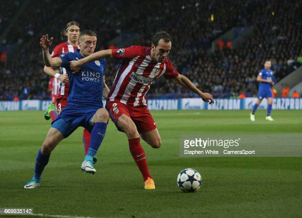 Leicester City's Jamie Vardy and Atletico Madrid's Diego Godin during the UEFA Champions League Quarter Final second leg match between Leicester City...