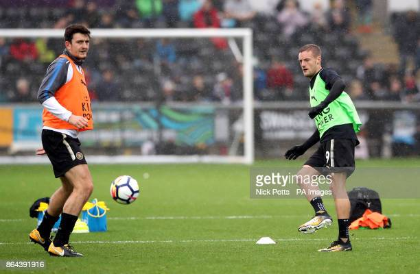Leicester City's Jamie Vardy and Harry Maguire warms up during the Premier League match at the Liberty Stadium Swansea