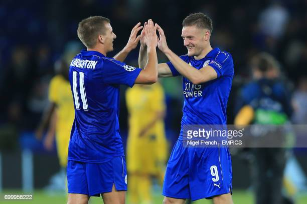 Leicester City's Jamie Vardy and Leicester City's Marc Albrighton celebrate after the final whistle