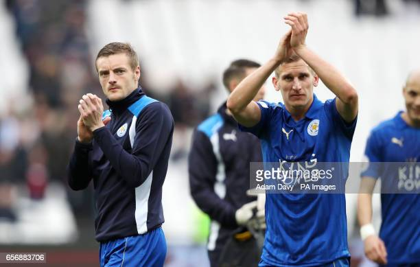 Leicester City's Jamie Vardy and Marc Albrighton applaud the fans after the game