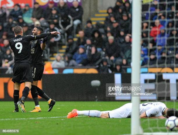 Leicester City's Jamie Vardy and Riyad Mahrez celebrate the opening goal after Swansea City's Federico Fernandez heads into his own net during the...