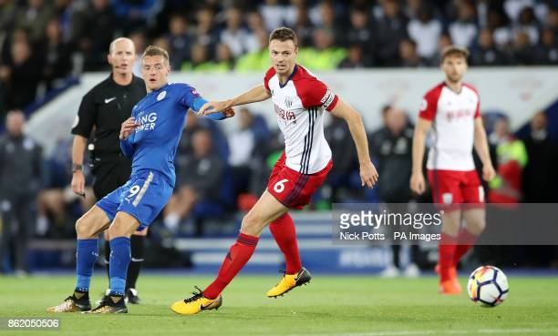 Leicester City's Jamie Vardy and West Bromwich Albion's Jonny Evans battle for the ball during the Premier League match at the King Power Stadium...