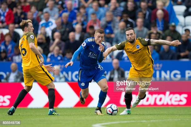 Leicester City's Jamie Vardy battles for possession with Brighton Hove Albion's Shane Duffy during the Premier League match between Leicester City...