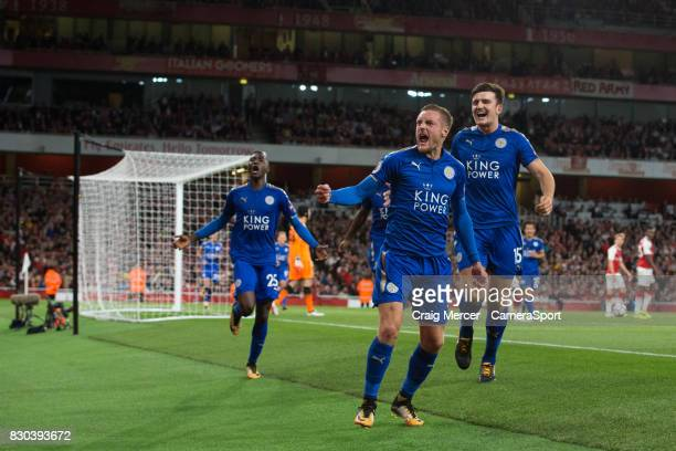 Leicester City's Jamie Vardy celebrates scoring his sides third goal with team mates during the Premier League match between Arsenal and Leicester...