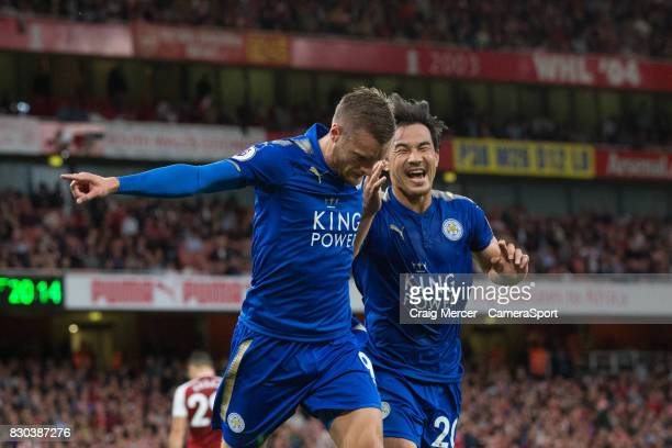 Leicester City's Jamie Vardy celebrates with Shinji Okazaki after scoring his sides second goal during the Premier League match between Arsenal and...