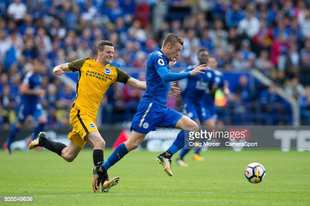 Leicester City's Jamie Vardy evades the challenge of Brighton Hove Albion's Jamie Murphy during the Premier League match between Leicester City and...