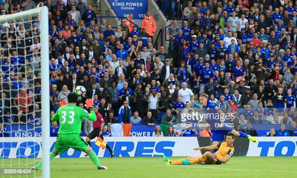 Leicester City's Jamie Vardy has an attempt on goal saved by Arsenal goalkeeper Petr Cech