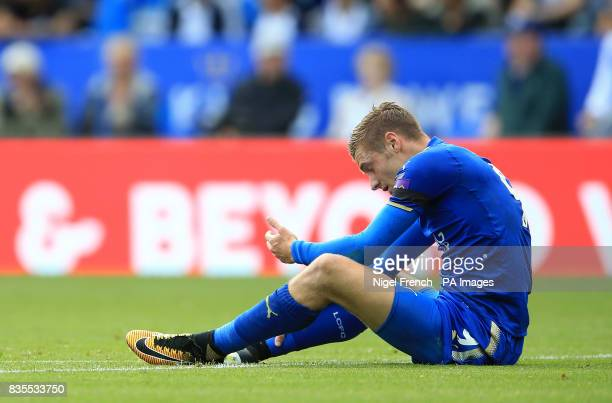 Leicester City's Jamie Vardy holds his faced after a collision during the Premier League match at the King Power Stadium Leicester