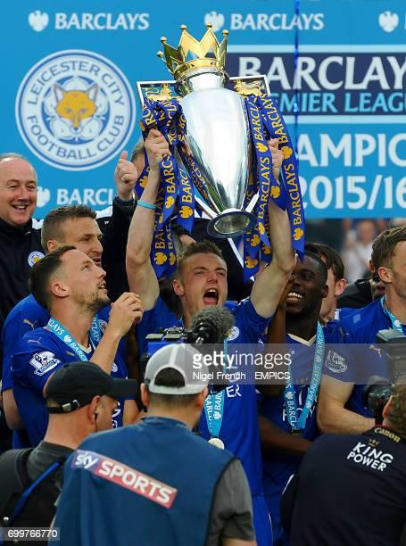 Leicester City's Jamie Vardy lifts the Barclays Premier League trophy