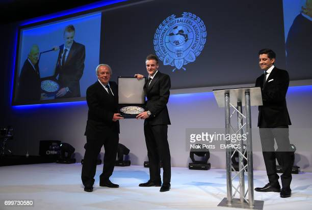 Leicester City's Jamie Vardy receives a commemorative plate for breaking the Premier League record for goals scored in consecutive from PFA Chief...
