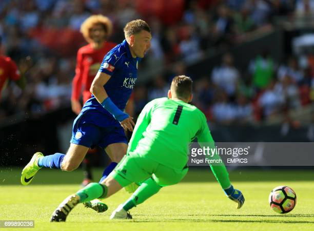Leicester City's Jamie Vardy scores his side's first goal of the game
