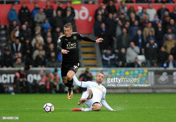 Leicester City's Jamie Vardy vies for possession with Swansea City's Leon Britton during the Premier League match between Swansea City and Leicester...