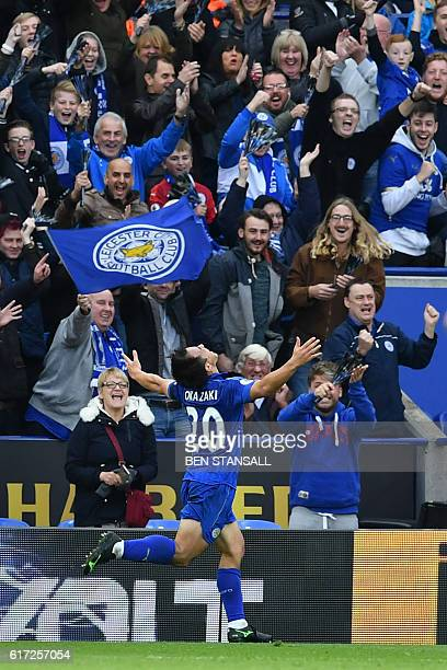 Leicester City's Japanese striker Shinji Okazaki celebrates after scoring their second goal during the English Premier League football match between...