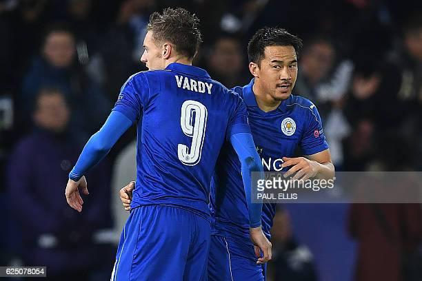 Leicester City's Japanese striker Shinji Okazaki celebrates scoring his team's first goal with Leicester City's English striker Jamie Vardy during...