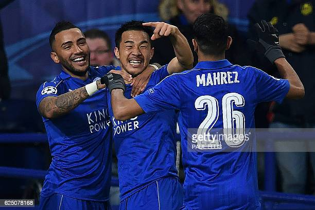Leicester City's Japanese striker Shinji Okazaki celebrates scoring his team's first goal during the UEFA Champions League group G football match...