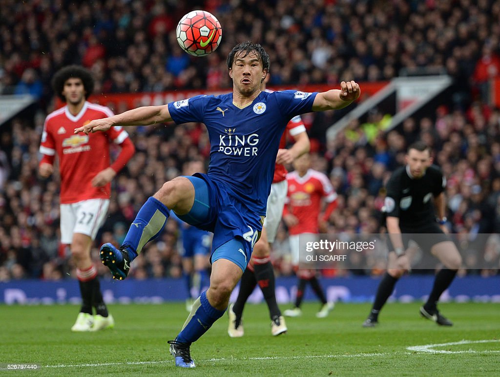 Leicester City's Japanese striker Shinji Okazaki prepares to strike the ball during the English Premier League football match between Manchester United and Leicester City at Old Trafford in Manchester, north west England, on May 1, 2016. / AFP / OLI SCARFF / RESTRICTED TO EDITORIAL USE. No use with unauthorized audio, video, data, fixture lists, club/league logos or 'live' services. Online in-match use limited to 75 images, no video emulation. No use in betting, games or single club/league/player publications. /