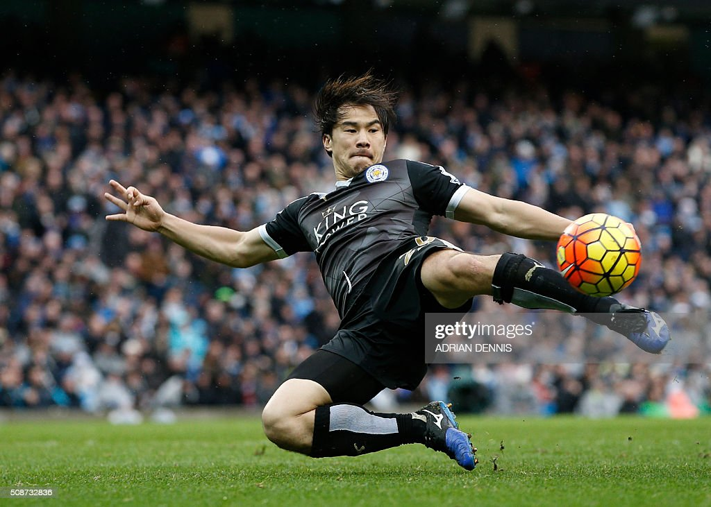 Leicester City's Japanese striker Shinji Okazaki strikes the ball during the English Premier League football match between Manchester City and Leicester City at the Etihad Stadium in Manchester, north west England, on February 6, 2016. / AFP / ADRIAN DENNIS / RESTRICTED TO EDITORIAL USE. No use with unauthorized audio, video, data, fixture lists, club/league logos or 'live' services. Online in-match use limited to 75 images, no video emulation. No use in betting, games or single club/league/player publications. /