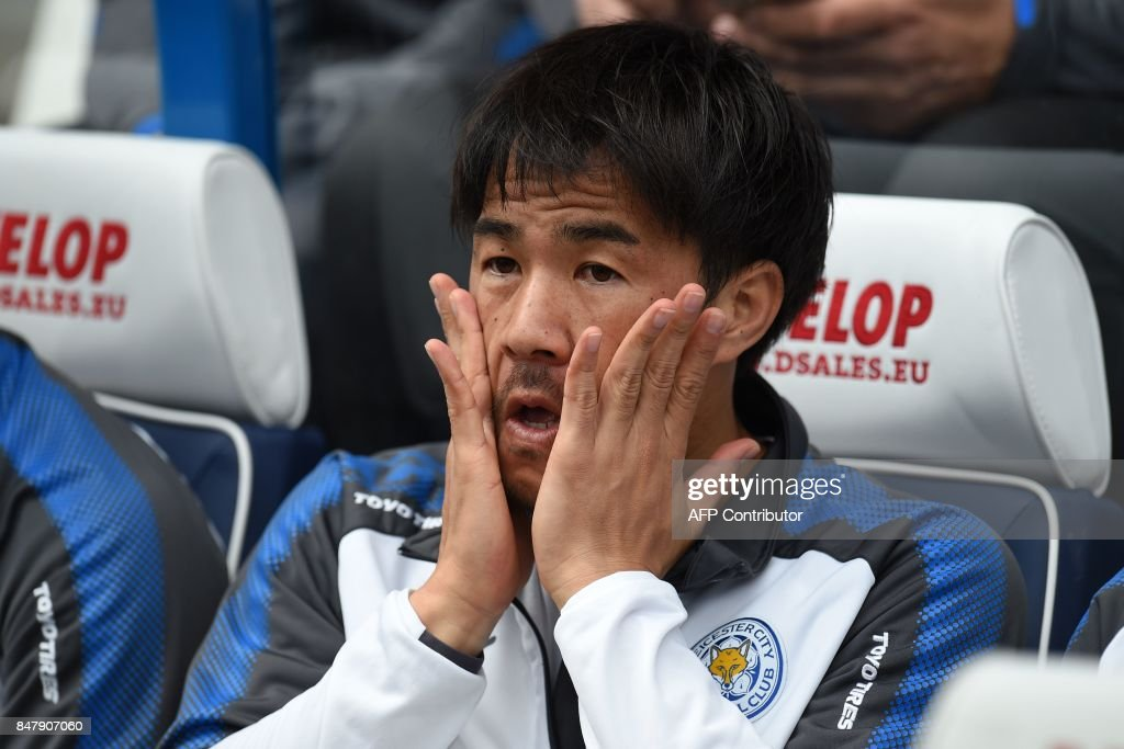 Leicester City's Japanese striker Shinji Okazaki takes his place on the bench ahead of the English Premier League football match between Huddersfield Town and Leicester City at the John Smith's stadium in Huddersfield, northern England on September 16, 2017. The game finished 1-1. / AFP PHOTO / Oli SCARFF / RESTRICTED TO EDITORIAL USE. No use with unauthorized audio, video, data, fixture lists, club/league logos or 'live' services. Online in-match use limited to 75 images, no video emulation. No use in betting, games or single club/league/player publications. /