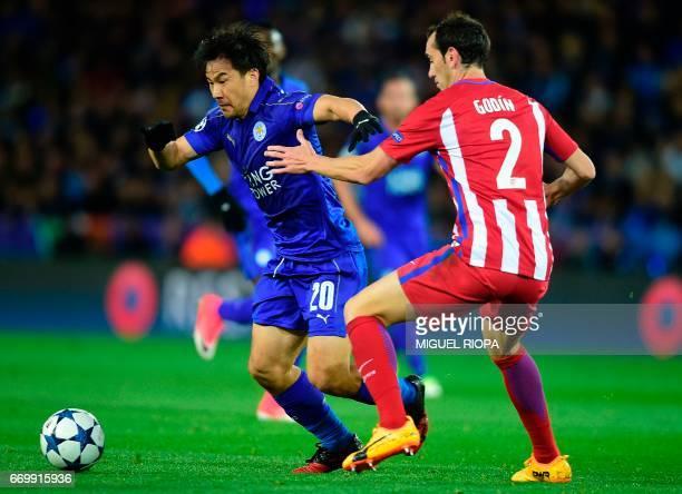 Leicester City's Japanese striker Shinji Okazaki vies with Atletico Madrid's Uruguayan defender Diego Godin during the UEFA Champions League...