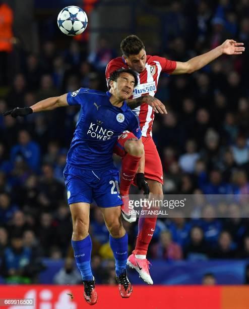 Leicester City's Japanese striker Shinji Okazaki vies with Atletico Madrid's Uruguayan defender Jose Maria Gimenez during the UEFA Champions League...