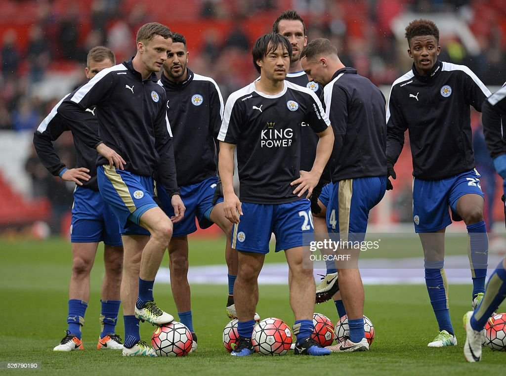 Leicester City's Japanese striker Shinji Okazaki (C) warms up before the English Premier League football match between Manchester United and Leicester City at Old Trafford in Manchester, north west England, on May 1, 2016. / AFP / OLI SCARFF / RESTRICTED TO EDITORIAL USE. No use with unauthorized audio, video, data, fixture lists, club/league logos or 'live' services. Online in-match use limited to 75 images, no video emulation. No use in betting, games or single club/league/player publications. /