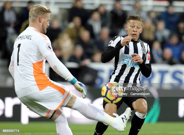 Leicester City's Kasper Schmeichel clears under pressure from Newcastle United's Dwight Gayle during the Premier League match between Newcastle...