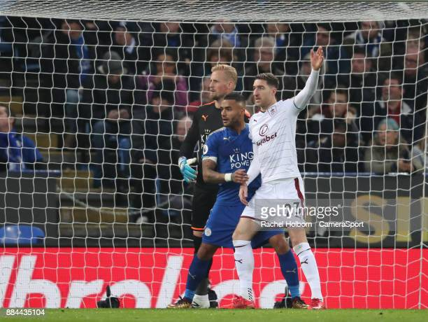 Leicester City's Kasper Schmeichel Leicester City's Danny Simpson and Burnley's Stephen Ward during the Premier League match between Leicester City...