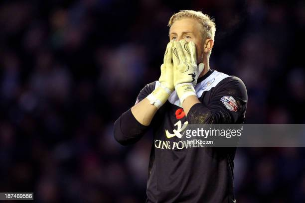 Leicester City's Kasper Schmeichel's reaction to David Nugent puting it over the bar from the penalty spot during the Sky Bet Championship match...