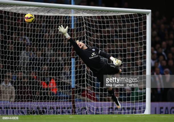 Leicester City's keeper Kasper Schmeichel dives but can not stop Aston Villa's Ciaran Clark scoring their first goal