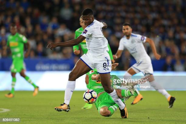 Leicester City's Kelechi Iheanacho is tackled by Borussia Monchengladbach's Laszlo Benes during a pre season friendly match at the King Power Stadium...