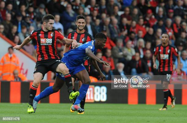 Leicester City's Kelechi Iheanacho shields the ball from Bournemouth's Lewis Cook during the Premier League match between AFC Bournemouth and...