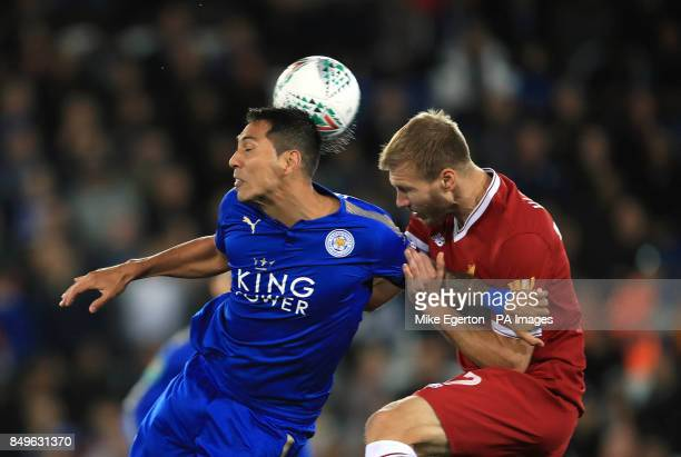 Leicester City's Leonardo Ulloa and Liverpool's Ragnar Klavan battle for the ball during the Carabao Cup third round match at the King Power Stadium...