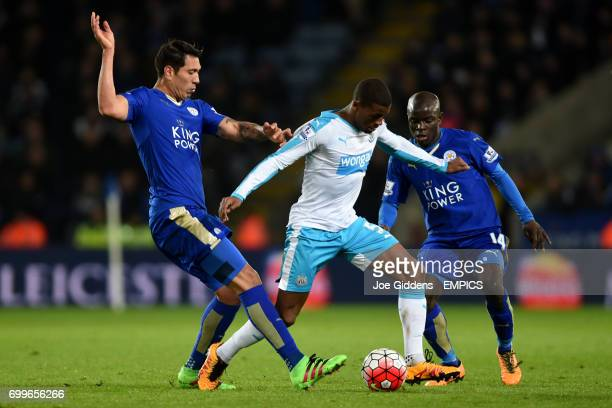 Leicester City's Leonardo Ulloa and N'Golo Kante battle for the ball with Newcastle United's Georginio Wijnaldum