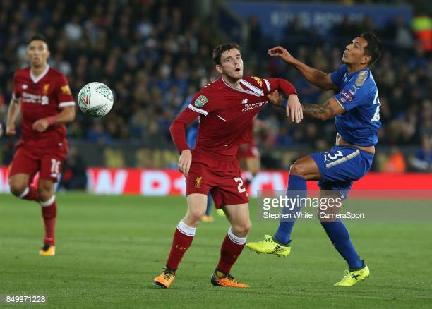 Leicester City's Leonardo Ulloa gets to grips with Liverpool's Andrew Robertson during the Carabao Cup Third Round match between Leicester City and...