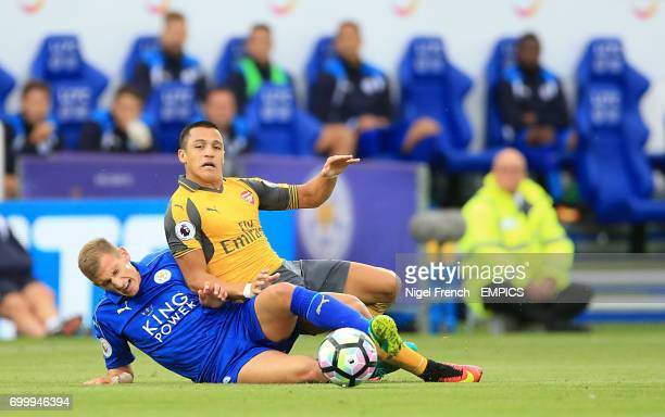 Leicester City's Marc Albrighton and Arsenal's Alexis Sanchez battle for the ball