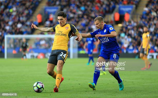 Leicester City's Marc Albrighton and Arsenal's Hector Bellerin battle for the ball