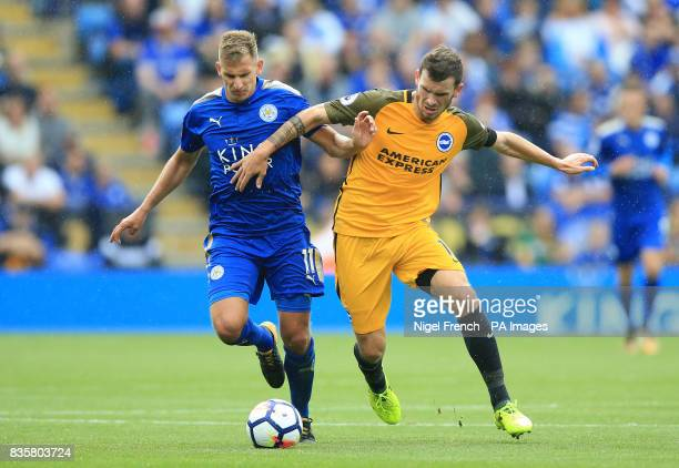 Leicester City's Marc Albrighton and Brighton Hove Albion's Pascal Gross battle for the ball during the Premier League match at the King Power...