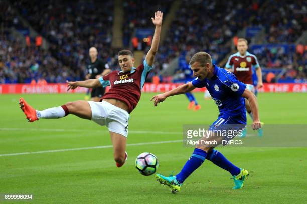 Leicester City's Marc Albrighton and Burnley's Matthew Lowton battle for the ball